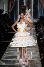 Joan Smalls looked whimsical in a tiered cake dress at the Moschino Fall 2020 show.