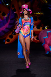 Alessandra Ambrosio showed off her toned physique in this psychedelic-chic one-piece while walking the Moschino runway.