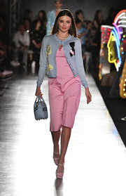 A pastel-blue cardigan amped up the ladylike vibe.