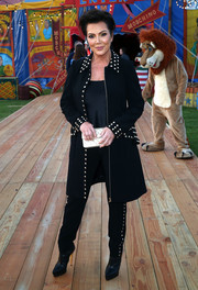 Kris Jenner rocked a studded coat and pants combo at the Moschino Resort 2019 show.