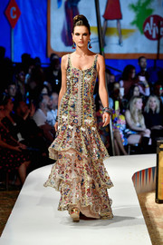 Alessandra Ambrosio looked opulent in a heavily embellished mermaid gown while walking the Moschino runway.