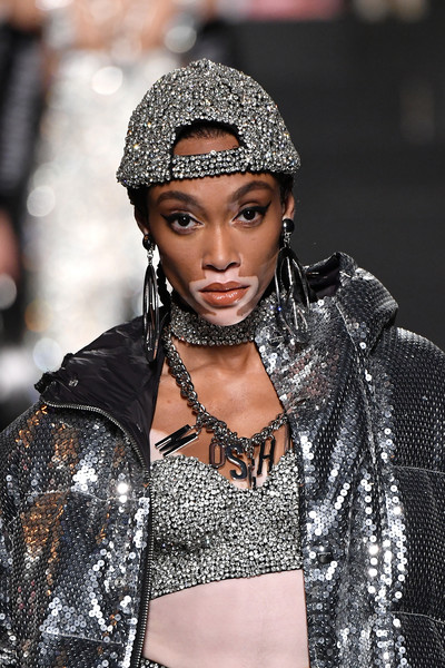 Winnie Harlow proved there's no such thing as too much silver when she wore this baseball cap, jacket, and bustier combo at the Moschino x H&M show.