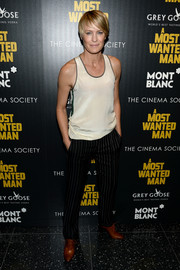 Robin Wright amped up the masculine feel with a pair of pinstripe slacks by Haute Hippie.