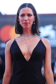 Rebecca Hall complemented her deep-V dress with a stunning diamond pendant necklace by De Beers for the Venice Film Festival premiere of 'Mother!'