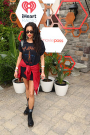 Shay Mitchell visited the MoviePass x iHeartRadio Festival Chateau wearing a Def Leppard tee and no pants!