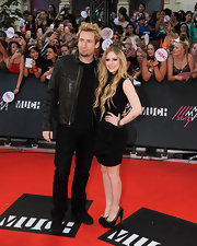 Avril stuck to her punk-princess look with this classic black dress, which featured a distinct ruffle design on the skirt.