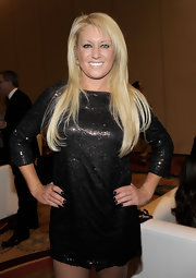 Natalie Gulbis sparkled in a sequined little black dress at Muhammad Ali's Celebrity Fight Night XVII.