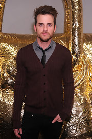 Jared Followill went for a preppy look with this striped brown cardigan, gray shirt, and black tie combo at the anniversary celebration of Mulberry.