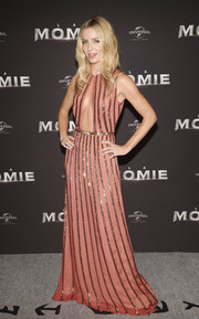 Annabelle Wallis turned heads in a coral Prada gown with gold stripes and a cleavage-baring cutout at the Paris premiere of 'The Mummy.'