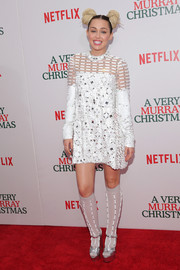 Miley Cyrus worked a blingy look in a heavily embellished sheer-panel shift dress by Prada at the New York premiere of 'A Very Murray Christmas.'