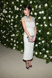 Caroline Sieber styled her top with an elegant tweed midi skirt, also by Chanel.