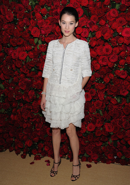 Astrid Berges Frisbey topped off her wite frock with strappy sandals.