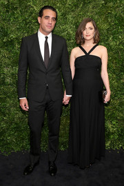 Rose Byrne showed off her elegant maternity style with this black halter gown by Chanel during the Museum of Modern Art's film benefit.