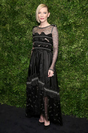 Cate Blanchett got all glammed up in a Chanel Couture beaded ruffle gown with a sheer yoke, sleeves, and hem for the Museum of Modern Art's film benefit.