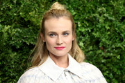 Diane Kruger contrasted her edgy 'do with an ultra-girly pink lip.