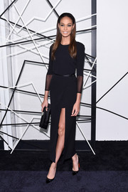 Joan Smalls completed her all-black look with an elegant satin clutch.