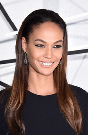 Joan Smalls went for an edgy beauty look with a heavy application of blue eyeshadow.