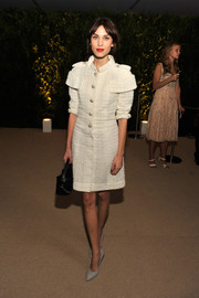 Alexa Chung looked downright classy in a white tweed coat by Chanel during the MoMA film benefit.