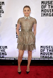 Chloe Grace Moretz donned a gold lace cocktail dress that was quintessentially Valentino for the Museum of the Moving Image event honoring Julianne Moore.