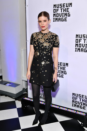 Kate Mara made her mini dress more winter appropriate with a pair of black tights.