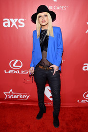 Orianthi Panagaris completed her edgy outfit with a pair of black leather skinnies.