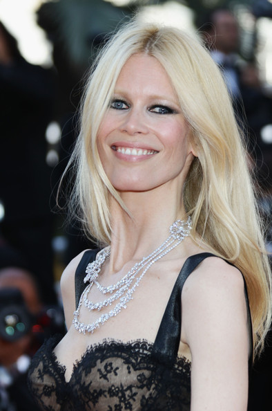 Claudia Schiffer styled her hair in a center part straight hairstyle at the Cannes premiere of 'This Must Be the Place.'
