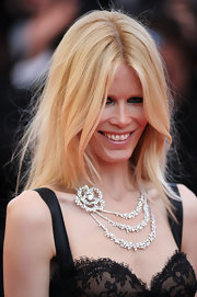 Claudia Schiffer paired her lace dress with a sparkling diamond flower necklace at the Cannes Film Festival.