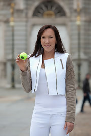 Jelena Jankovic's two-tone cropped jacket featuring embroidered sleeves was a super-stylish finish to her outfit at the Madrid Open previews.