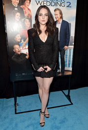Elizabeth Gillies complemented her LBD with classic black ankle-strap heels.