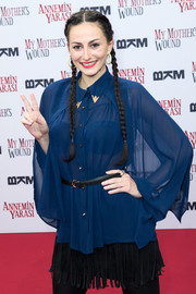 Marla Blumenblatt shows off her double braids at the 'My Mothers Wound'  premiere.