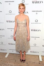 Michelle Williams topped off her frilly chiffon frock with black peep-toe pumps.