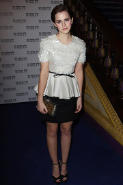 Emma Watson was perfectly chic at a screening of 'My Weekend With Marilyn' in a dove gray Swarovski beaded peplum blouse.