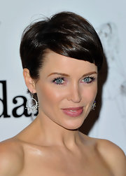 Dannii Minogue's pixie haircut was as adorable as ever at the 'MyDaily' Amazing Women Celebrations. To try her look, add a product like Fekkai Coiff Extra Control Styling Gel to damp hair for extra shine and hold. Next, part hair and begin blow-drying tresses with a brush, comb or fingers. Direct bangs to move across the forehead and the rest of the hair back behind the ears. Once hair is dry, lightly tousle for volume, smooth a little with fingers and mist with hairspray.