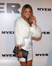 Laura Dundovic infused a rocker-chic touch to her glamorous outfit with a black chain-strap bag at the Myer Autumn/Winter Collection launch.
