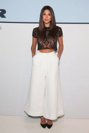 Pia Miller stayed on trend with a pair of white ankle-length culottes.