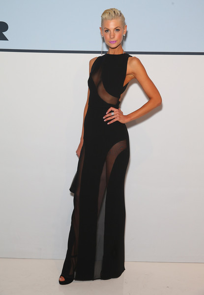 Kate Peck looked red carpet-ready in a sheer-panel black gown during the Myer Spring 2015 fashion launch.