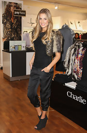 Laura Dundovic complemented her fab jacket with a pair of laid-back peep-toe wedge boots during an event at Myers.