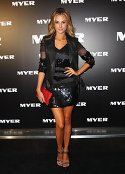 Laura Dundovic complemented her dark outfit with a metallic red clutch for a pop of rich color at the Myer Autumn/Winter Collection launch.
