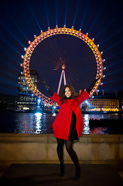 Myleene brightens up winter in a red coat over a black ensemble.