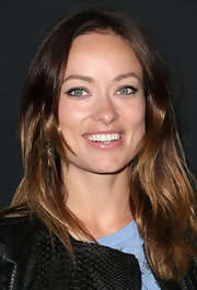 Olivia Wilde look simple and chic with a swipe of clear lip gloss.