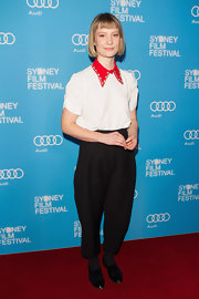 Mia Wasikowska showed off her quirky style with this white blouse that featured a big and bold red embellished point collar.