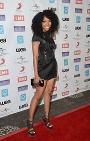 Brandy paired strappy sandals featuring clear acrylic wedge heels with her cool LBD.