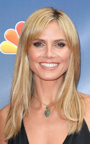 Heidi Klum accessorized with a cute heart pendant necklace.