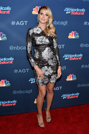 Heidi Klum polished off her look with beaded strappy heels.