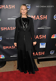 Uma Thurman looked dramatic in a long blazer and floor-sweeping satin gown at the 'Smash' premiere.