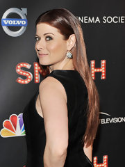 Debra Messing smoothed out her naturally curly tresses and wore her long locks looking ultra-sleek at the premiere of 'Smash.
