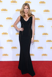 Kate Upton went for sexy elegance in a cleavage-baring black evening dress by Antonio Berardi during the Sports Illustrated Swimsuit Issue 50th anniversary bash.