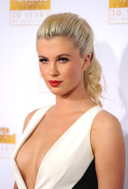 Ireland Baldwin looked just like a doll with her curly ponytail at the Sports Illustrated Swimsuit Issue 50th anniversary bash.