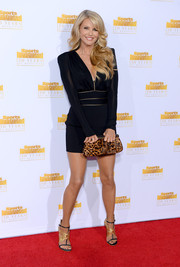 Christie Brinkley teamed her LBD with black and gold butterfly sandals by Sergio Rossi for a head-to-toe chic look.