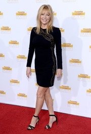 Cheryl Tiegs's black evening sandals added a touch of sexiness to her look.